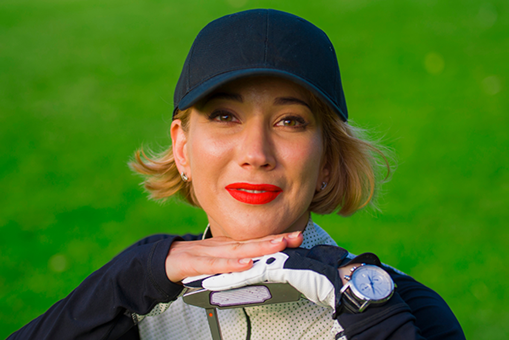 Woman golfer smiling resting her chin on her hands